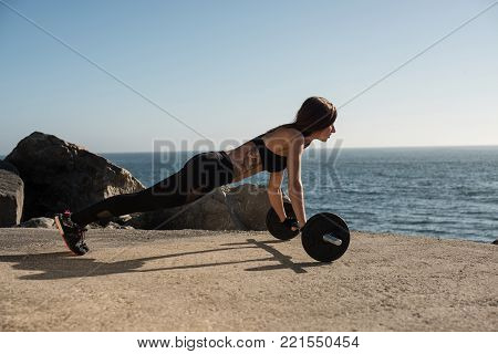 Fit Woman Lifting Weights - Outdoor