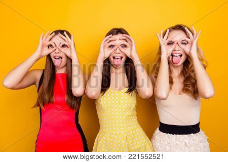 Three Pretty, Charming, Attractive, Nice, Trendy, Crazy Girls Showing Binoculars With Fingers, Hands
