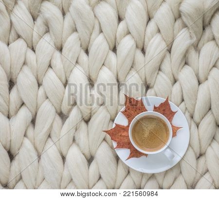 Cozy composition, closeup merino wool blanket, warm and comfortable atmosphere. Knit background. Autumn background. Knit background.