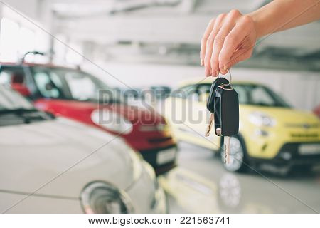Passing car keys. Cropped closeup of a car dealer holding out car keys to the camera copyspace car dealership salon manager salesman selling buying giving owner profession purchase vehicle concept