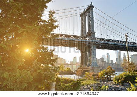 View of Manhattan Bridge from the Brooklyn Bridge Park at sunset.