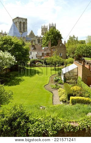 York, Yorkshire, England, UK - May 22, 2016 : A back garden view of the historical York Minster the cathedral of York