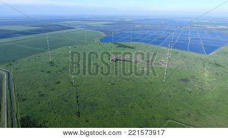 Masts longwave antennas communication among the rice fields flooded. Telecommunications and communications equipment and radar.