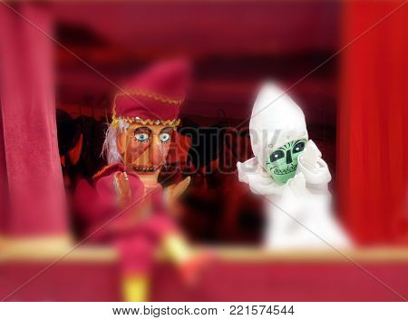 Closeup of punch and ghost puppets with blur effect