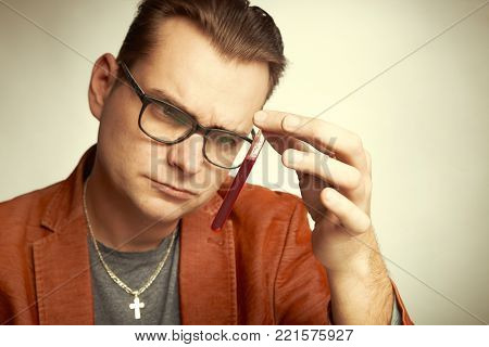 Drug dealer watching test tube for quality of delivery with chemicals poster