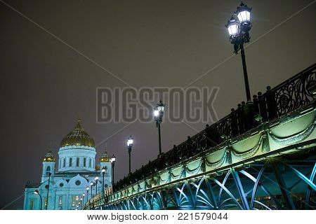 Night winter view to the Cathedral of Christ the Saviour with bridge and street lights