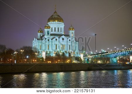 Night winter view to the Cathedral of Christ the Saviour from another side of river