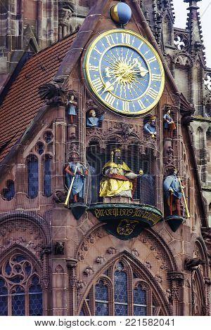 Details of facade with clock on Frauenkirche Church of Our Lady is a catholic church in Nuremberg, Germany. Gothic architecture in Bavaria.