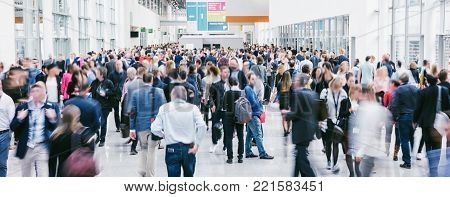 Crowd Of Anonymous Blurred People At A Trade Fair