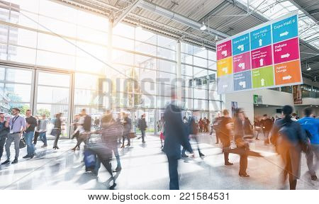 crowd of business people rushing in a floor at a trade fair. ideal for websites and magazines layouts