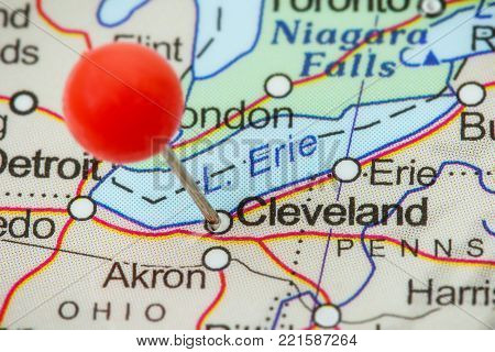 Close-up of a red pushpin in a map of Cleveland, USA.