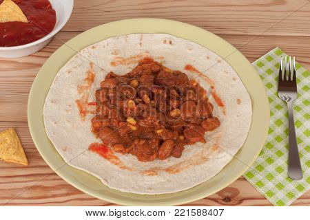 Chili Con Carne On Tortilla Wrap With Salsa Sauce And Tortilla Chips