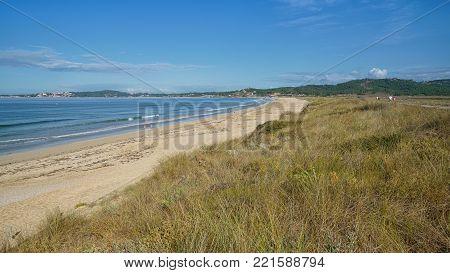 O GROVE, SPAIN - SEPTEMBER 16, 2017: Beautiful beach Playa de A Lanzada close to O Grove, coast of Galicia on September 16, 2017 in Spain