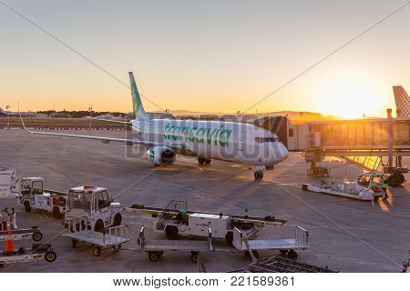 Valencia, Spain - Dec 17, 2017: Arrival of Transavia commercial low-cost flight on Valencia airport at sunset on 17th of December, 2017 on in Valencia.