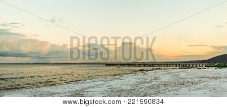 Baltic sea bay Gdynia pier in Orlowo Poland. Beautiful winter landscape