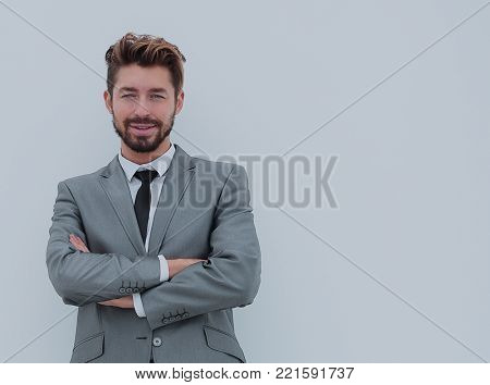 Portrait of a smiling handsome business man  over white backgrou