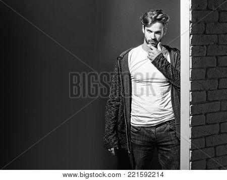Handsome Man Puts On Suspenders