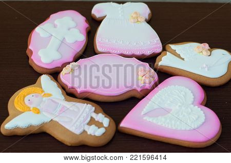 Holiday cakes with pink, white glaze. Shapes of girl, bird, heart, dress. Focus on central cake