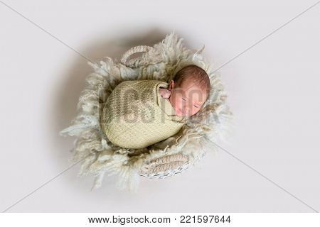 Cute sleeping newborn baby smiles