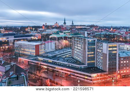 Aerial panoramic cityscape with modern buildings and Medieval Old Town with Saint Nicholas Church, Cathedral Church of Saint Mary and Alexander Nevsky Cathedral in Tallinn in the evening, Estonia