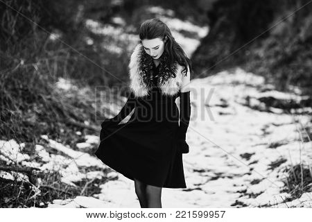 Black and white art monochrome photography. Striking girl with long hair in black clothes. Black and white creative photography. Black and white conceptual image. Beautiful black and white background. Black and white portrait.