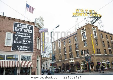 FLAGSTAFF, ARIZONA, USA- NOVEMBER 12, 2017: Beautiful view of the historic city center of Flagstaff with famous Hotel Monte Vista on cloudy day in winter in northern Arizona American Southwest USA