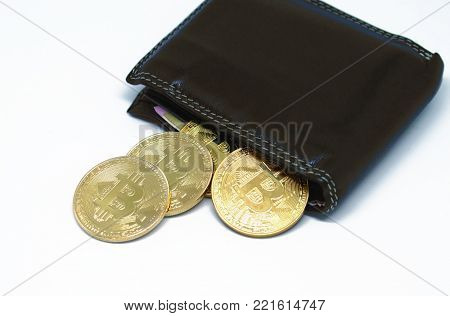 Bitcoin wallet with coins on a white background. Bitcoin - modern virtual money.