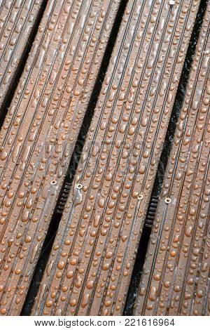 decking boards with water drops, beads off on impregnated wood