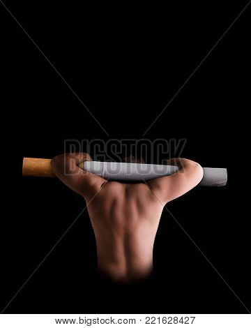 A man carries a cigarette as a symbol of nicotine slavery