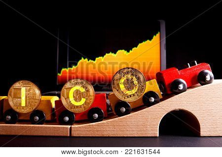 ICO Initial coin offering method of funding startups and business projects. Words ICO as a symbol of cashflow for funding startup. On laptop screen are quotes electronic currencies.