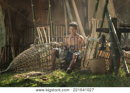 Father and son with a rustic career living in the countryside.Farmer thailand,Handmade craftsmanship of rattan chair craftsmen in rural Thailand.