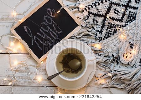Flat lay with cup of green tea, blackboard with chalk written word
