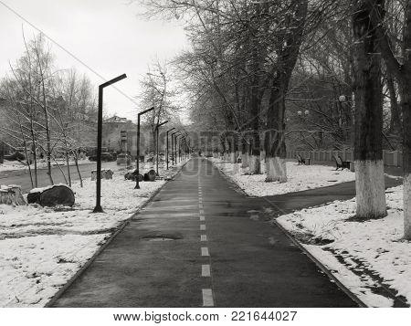 Sidewalk on the street of the old town. Winter landscape. Winter sidewalk.