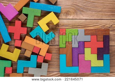 Logical tasks composed of colorful wooden shapes. Visual conundrum. Concept of creative, logical thinking or problem solving. Business concept, rational solution.