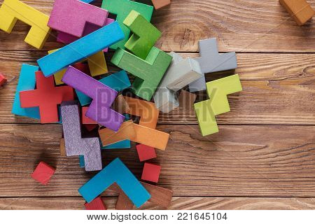 Abstract background with different colorful shapes wooden blocks. Geometric shapes in different colors. Concept of creative, logical thinking.