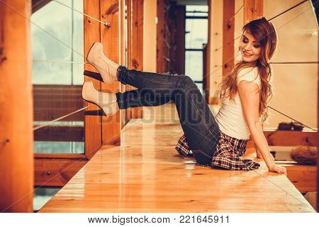 Alluring seductive gorgeous woman. Attractive young girl with long hair wearing white shirt and jeans trousers. Instagram filter.
