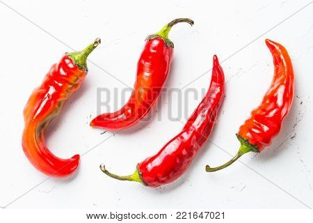 Red hot chilli pepper on white background. Top view.