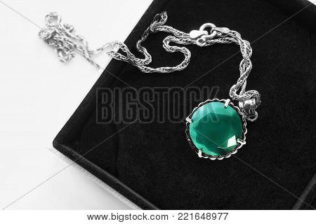 Elegant vintage topaz faceted pendant in black jewel box closeup