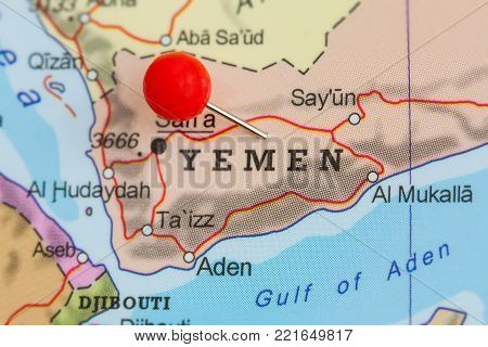 Close-up of a red pushpin on a map of Yemen.