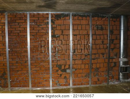 Insulation Of Brick Walls And Chimneys. Steel Carcass Of Their Profile For The Insulation Of Walls,