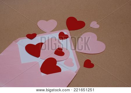 Envelope with Many Paper Hearts for Sending Love. Valentine's Day.