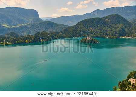 View of Bled lake with alps and picturesque island, view from the Bled Castle upper yard, Slovenia.