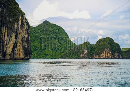 Azure water of the Ha Long Bay at the Gulf of Tonkin of the South China Sea, Vietnam. Scenic view of blue lagoon and karst towers-isles. The Halong Bay is a popular tourist destination of Asia.