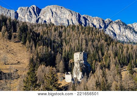 Landscape with ruined castle at the Dolomites in northeastern Italy