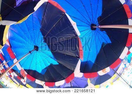 Bottom view of beach umbrella at Bangsan beach Chonburi Thailand.