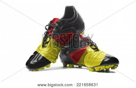 The Belgian flag painted on football boots. Isolated on white background.