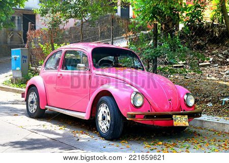 Palenque, Mexico - May 23, 2017: Pink retro car Volkswagen Beetle in the town street.