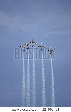 ROME - JUNE 29: The italian acrobatic team Frecce Tricolori perform at the Rome International Air Show on June 29, 2014 in Rome, Italy