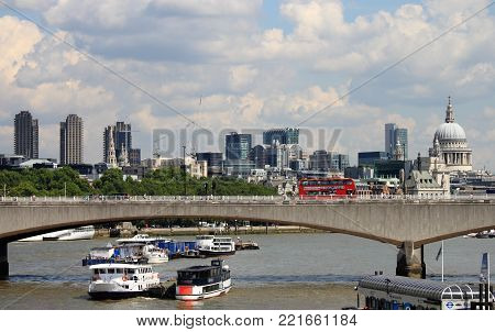 LONDON - AUGUST 7: London city skyline from the river Thames on August 7, 2014 in London, UK