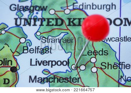 Close-up of a red pushpin in a map of Liverpool, United Kingdom.